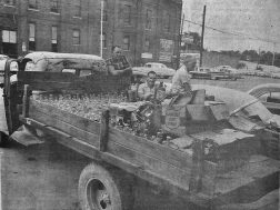 A circa 1960 moonshine still raid was successful. The evidence was brought to the sheriffs office .