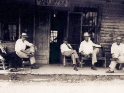 Sitting on the porch of the White's store in Subligna, circa 1920s,