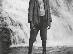 A young boy at Desoto Falls, His mother was a cook for a group of campers from the county, circa 1915